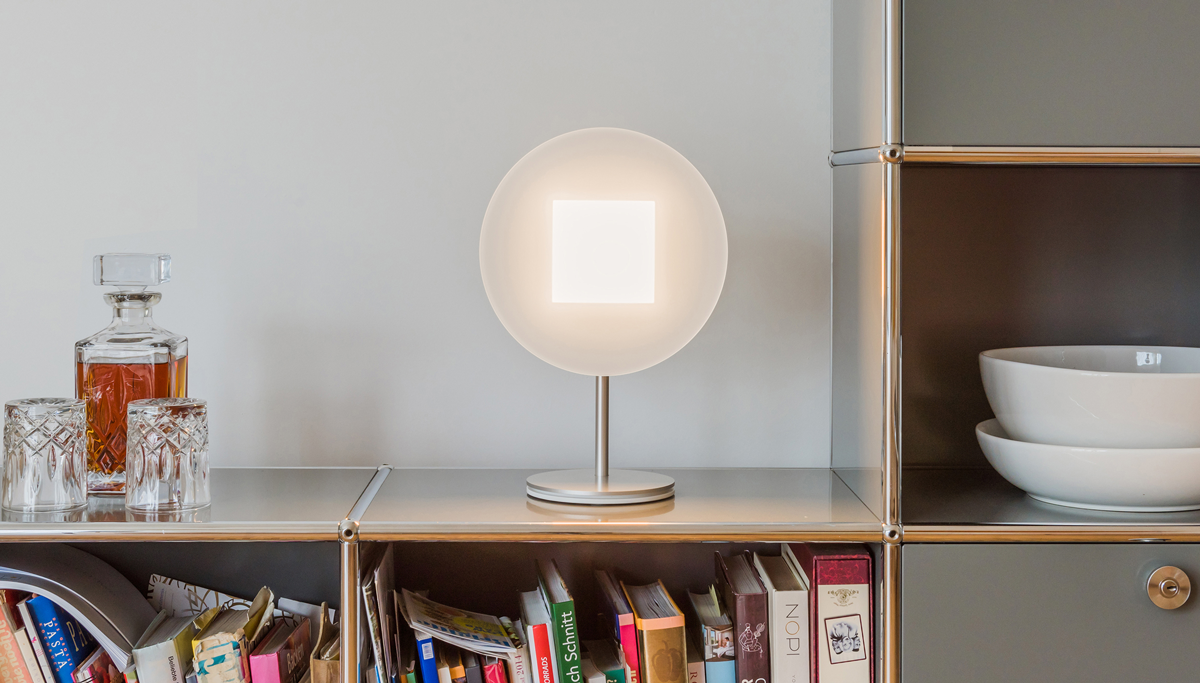 OMLED Round t1 OLED table lamp on a shelf