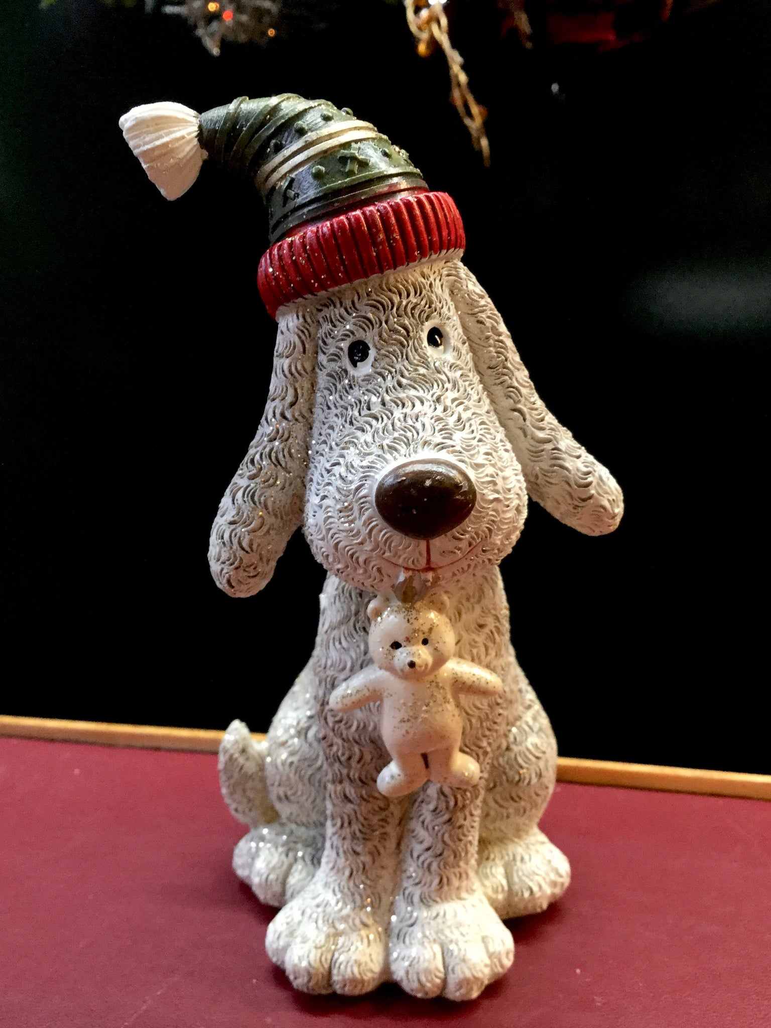 Dog with Hat and Teddy Bear on Mouth
