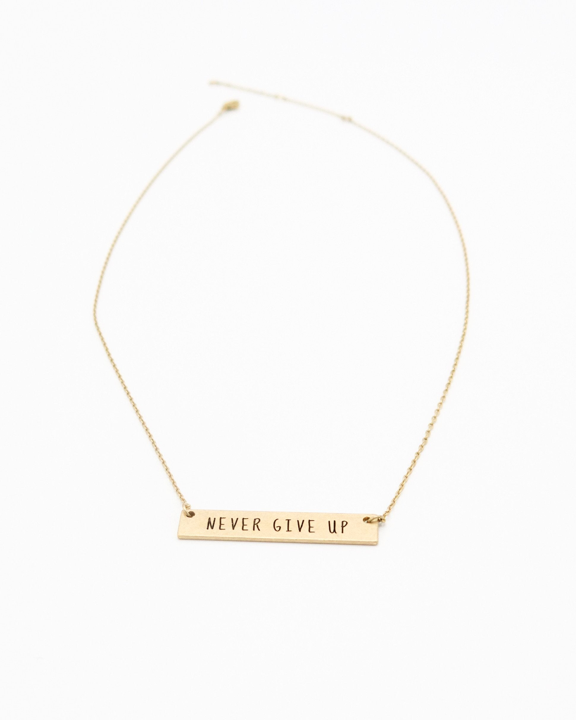 Never Give Up Inspirational Bar Necklace in gold