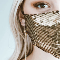 Girl in mask with  chain