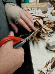 shaping the cork triangles by cutting them to create the tree