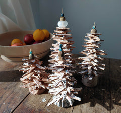 4 different finished cork mini Christmas trees