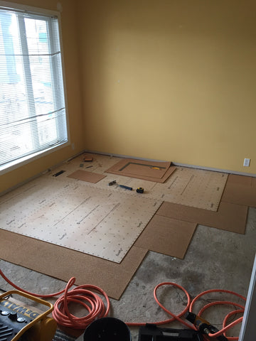 Multipurpose room after removing old carpets and starting the install of quiet cork and new subfloor.