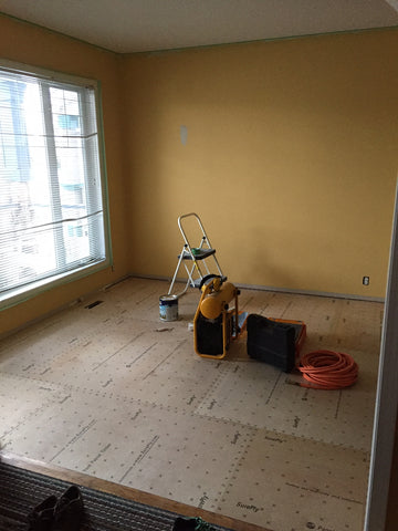 Multipurpose room after new subfloor installed over QuietCork.