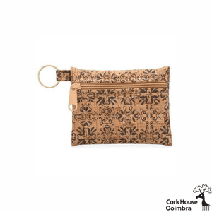 The Coimbra keychain wallet features a traditional ink printed tile pattern on natural cork fabric with a tan zipper and golden keyring.