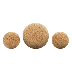 Close up of two 2-inch natural cork massage balls and one 3-inch natural cork massage balls.