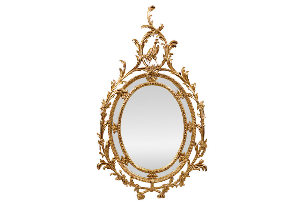A FINE LATE 19TH GILTWOOD OVAL MIRROR - REF No. 6010