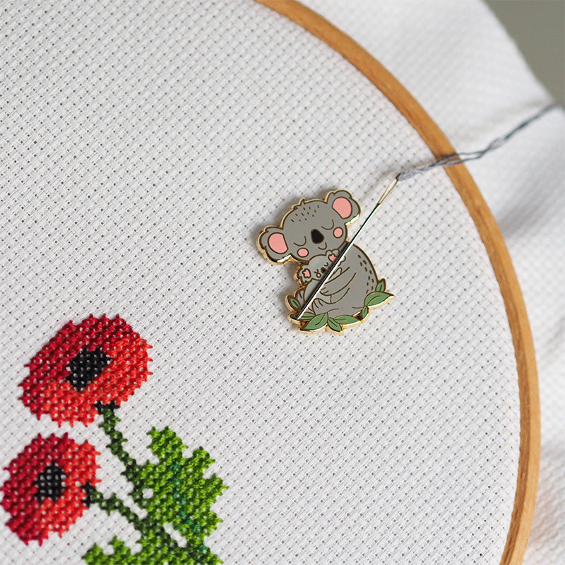 needle minders for cross stitch