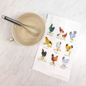 Paper Sharks Flour Sack Towel with a depiction of 9 breeds of hens in 3 rows of 3: Australorpe, Rhode Island Red, Polish, Brahma, Leghorn, Americana, Plymouth Rock, Wyandette, Orpington The towel is next to a cream spouted Mason Cash mixing bowl with a whisk sitting inside