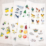 A variety of Paper Sharks Flour Sack Towels overlapping in two rows of four