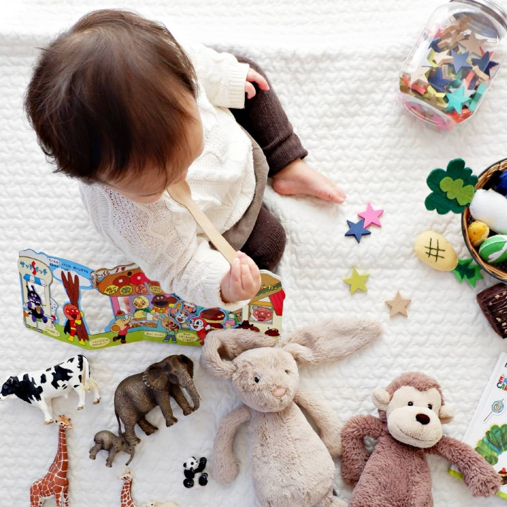 baby playing with toys-zabecca living