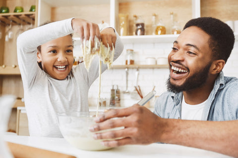 parent and child baking together - kids new years resolutions