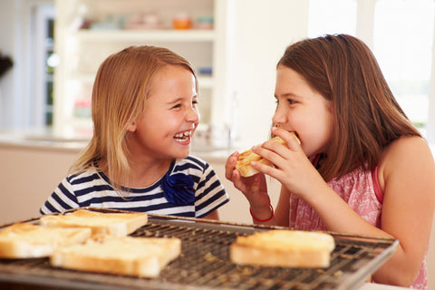 two girls eating grilled cheese - memorial day indoor grilling