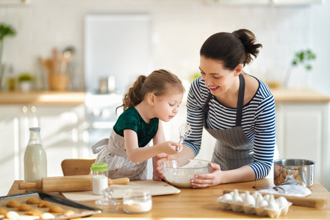 mother and daughters making spring no-bake recipes