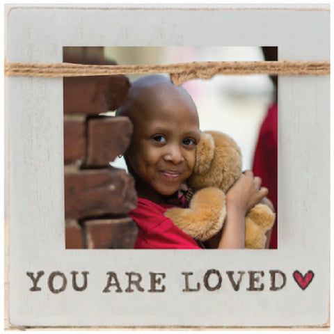 """YOU ARE LOVED"" Frame with CURE logo on back"