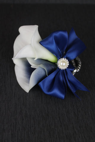 A Navy Picasso Calla Lily Corsage