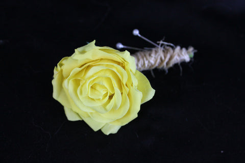 A Rustic yellow Rose Boutonniere