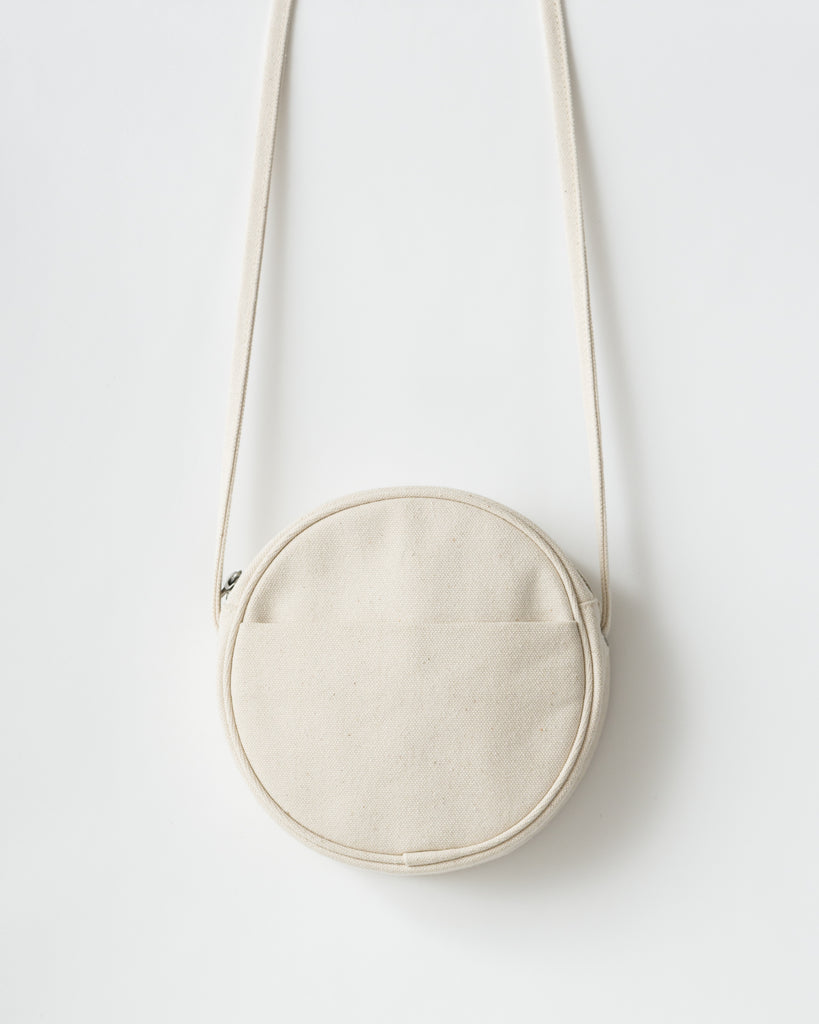 Small Canvas Circle Purse - Canvas Purse - Natural Canvas - White - A canvas cross body purse in a circle shape. - Tags: Canvas purse, canvas bag, cross body purse, solid