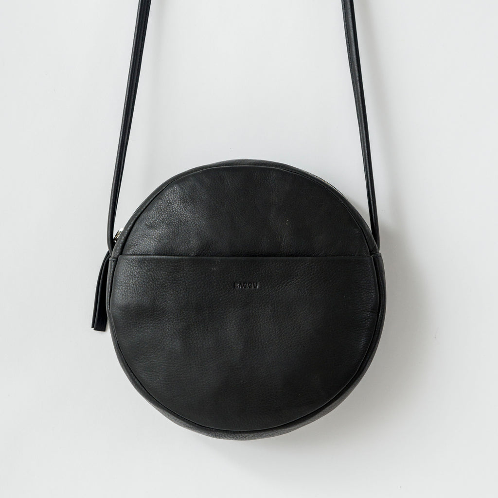 Circle Purse - Leather Purse  - Black - Black - A black leather purse in a circle shape. - Tags: Leather purse, black purse, circle purse, leather bag, cross body purse