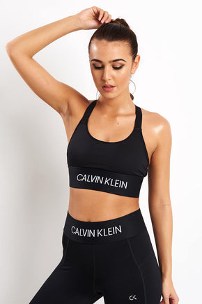 95bea2b09f557 Calvin Klein Performance Crossback Mid Impact Sports Bra image 1 - The  Sports Edit