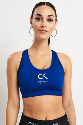 fcee97e7c65 Calvin Klein Performance Racerback Logo Bra - Surf The Web image 1 - The  Sports Edit
