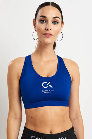 ad75dab01b137 Calvin Klein Performance Racerback Logo Bra - Surf The Web image 1 - The  Sports Edit