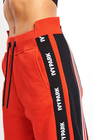 Ivy Park Asymmetric Stripe Joggers - Red image 4 - The Sports Edit