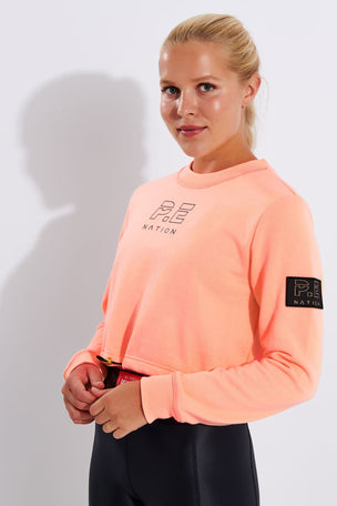 PE Nation Replay Sweat - Pop Peach image 1 - The Sports Edit