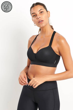 b1e0c8c56b997 Triumph Triaction Magic Motion Push Up Sports Bra - Black image 1 - The  Sports Edit