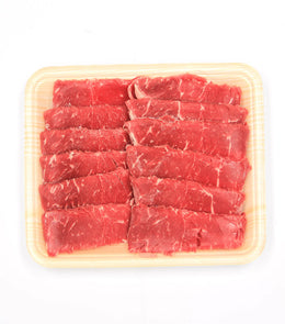 Pure, succulent slices of fresh shabu-shabu beef sirloin with some fresh vege by side