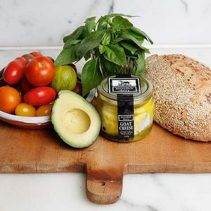 Load image into Gallery viewer, Meredith's Australian Marinated Goat Cheese paired with Avacado, Fresh, Red Grape Tomatoes and Gluten free loaf