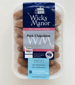Grilled Wicks Manor English Pork Sausage Chipolatas with garlic, red grade tomato and spice by side