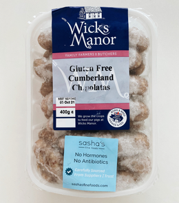 Grilled gluten-free Wicks Manor English Cumberland Chipolatas with garlic, red grade tomato and spices by side
