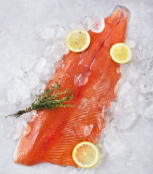 Load image into Gallery viewer, Beautiful fresh cut sashimi grade salmon skin-on from Sasha's Fine Foods