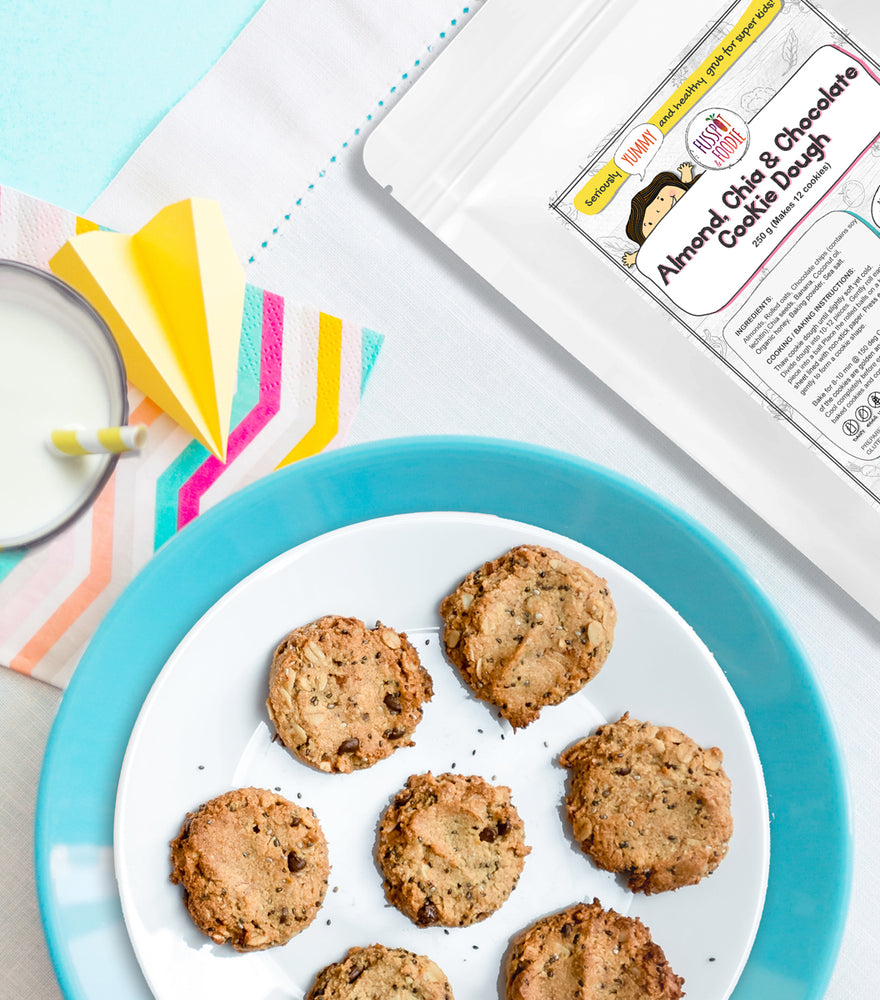 Load image into Gallery viewer, Almond, Chia & Chocolate Chip Cookie on a white sky blue plate