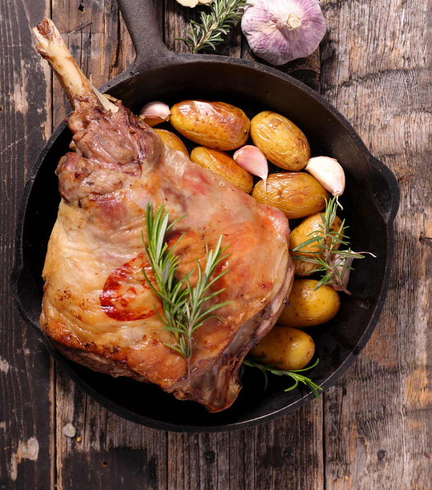 Deliciously cooked Organic lamb leg - Bone in on a pan