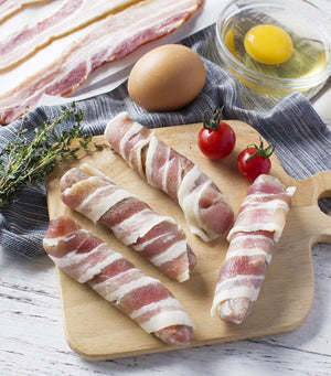 Load image into Gallery viewer, Wicks Manor English Pork Chipolatas wrapped in Smoked Streaky Bacon