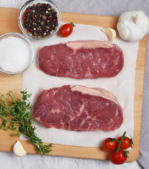 Load image into Gallery viewer, 2 slices perfect cut of fresh New Zealand Angus Beef Striploin Steaks with red grape tomato, garlic and spices
