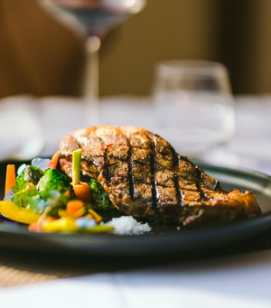Load image into Gallery viewer, Deliciously grilled NZ Angus Beef Striploin Steak with mix vege aside ready to serve