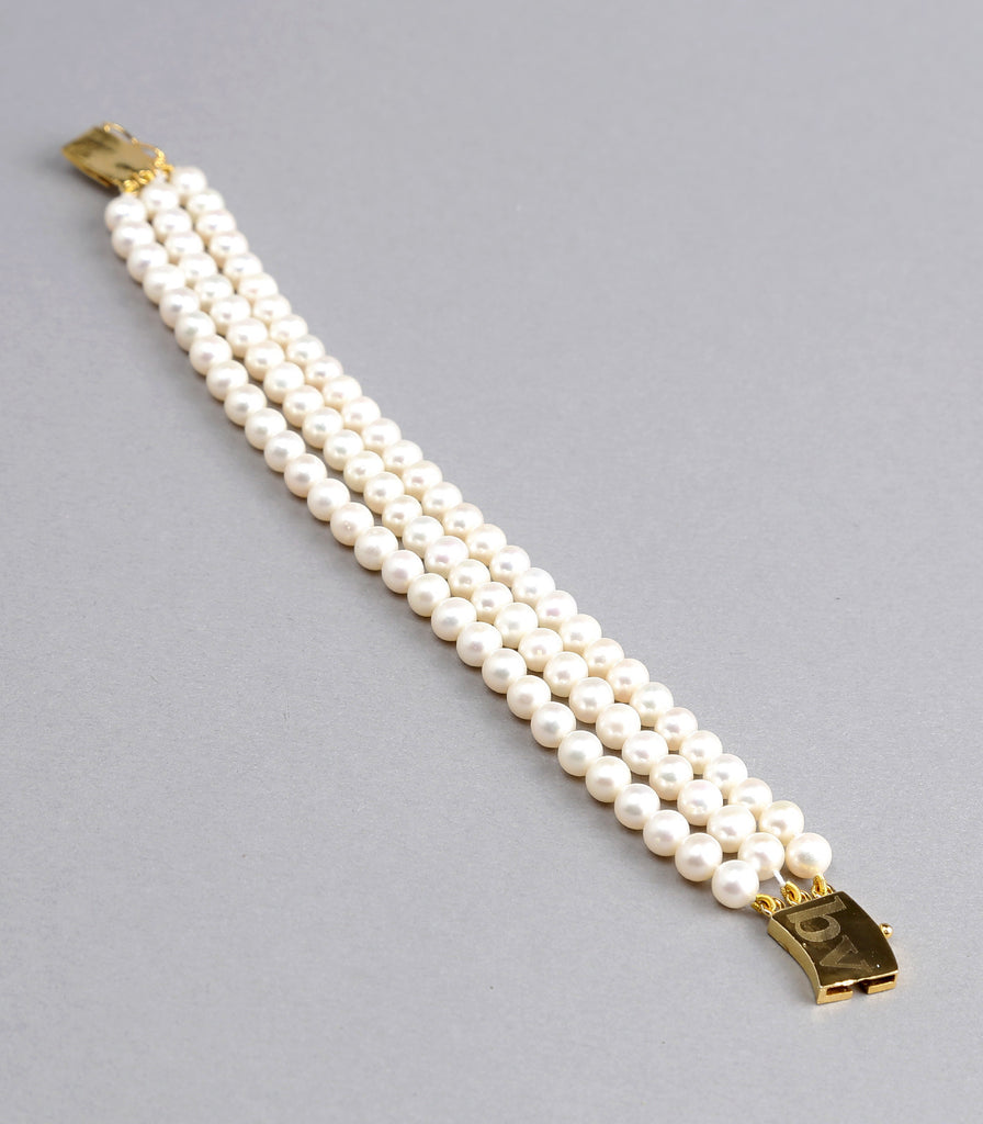 Triple Strand White Fresh Water Pearls Bracelet with Golden Clasp