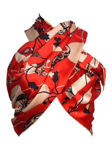 Red silk scarf hosting nature inspired leaves design