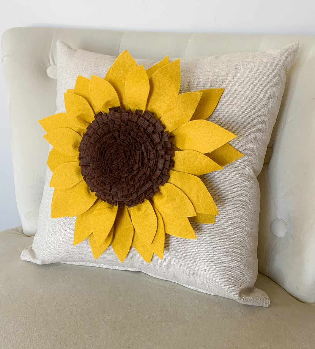 Decorative Pillow with Mustard yellow Sunflower made from wool felt on oatmeal colored pillow