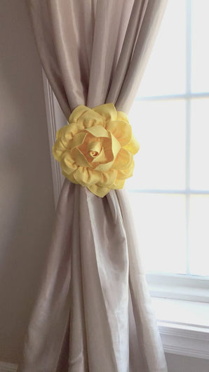 3d Bright Yellow Dahlia Flower Curtain Tie tied around curtain panel in front of window