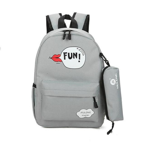 555a0475093 2017 New Print mouth Girls Backpack Junior High School Students Package  Female Campus letter fun Canvas