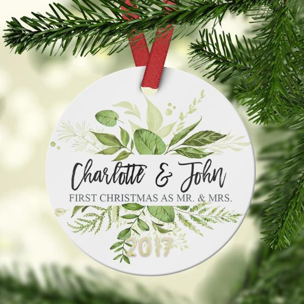 First Christmas as Mr. and Mrs. Ornament with greenery