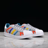 WHITE MOUNTAINEERING X ADIDAS SUPERSTAR - LIGHT GREY / MULTI