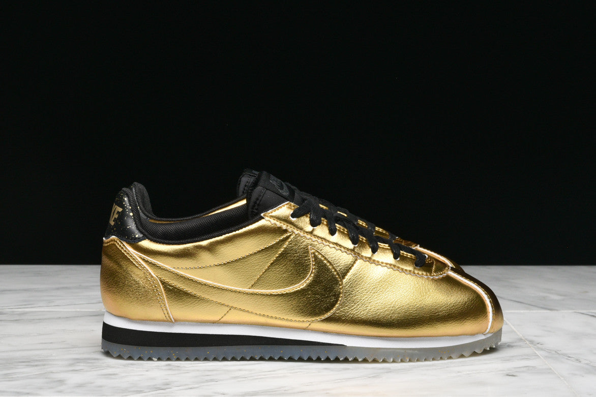 WMNS CLASSIC CORTEZ LEATHER SE (WMNS) - METALLIC GOLD