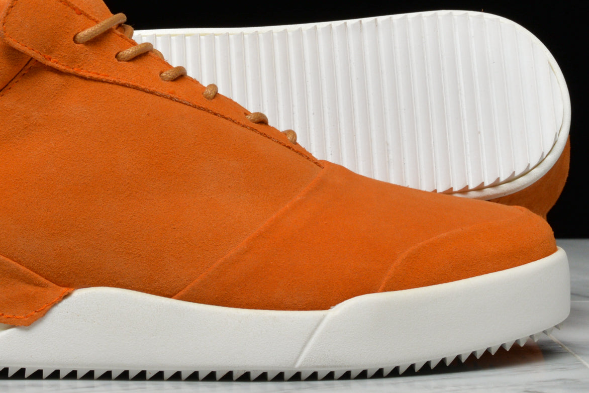 001 BY JOHN GEIGER - CLAW/BURNT ORANGE