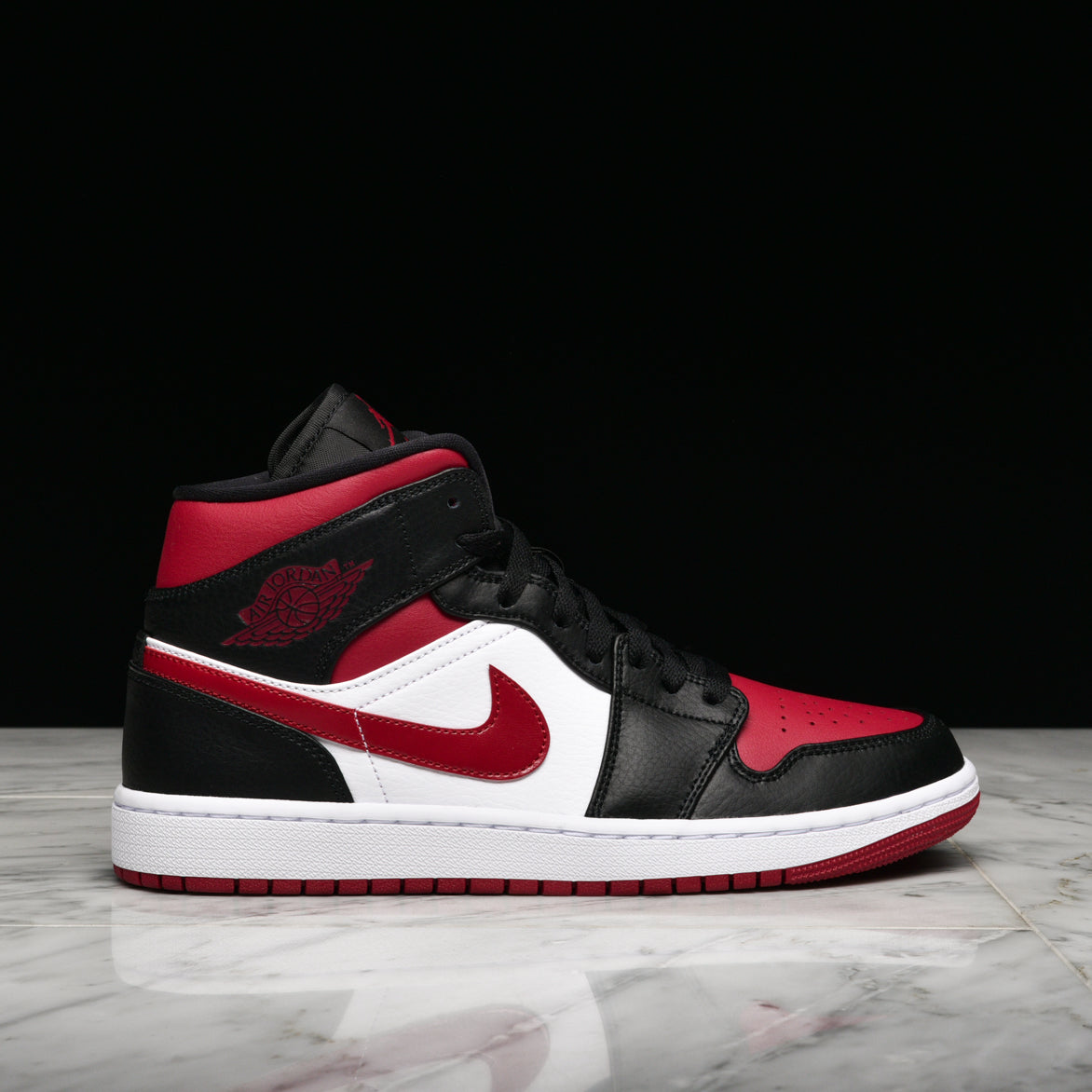 AIR JORDAN 1 MID - BLACK / NOBLE RED / WHITE