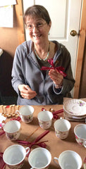 Nancy at Roses And Teacups making Teacup favors